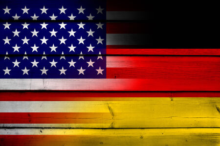 USA and Germany Flag on wood background photo