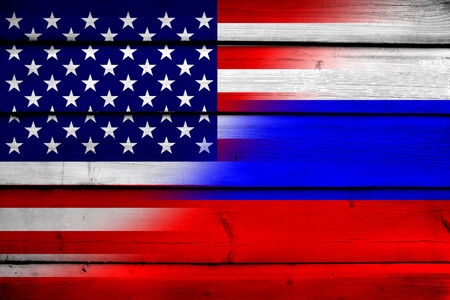 commonwealth: USA and Russia Flag on wood background
