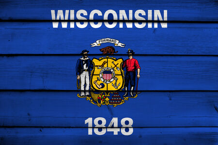 wisconsin state: Wisconsin State Flag on wood background