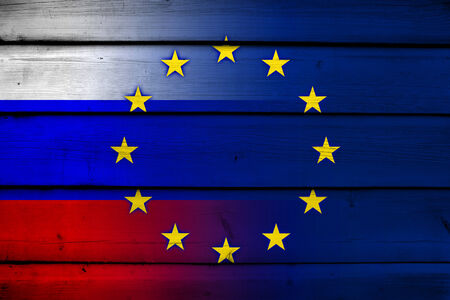 separatist: Russia and European Union Flag on wood background