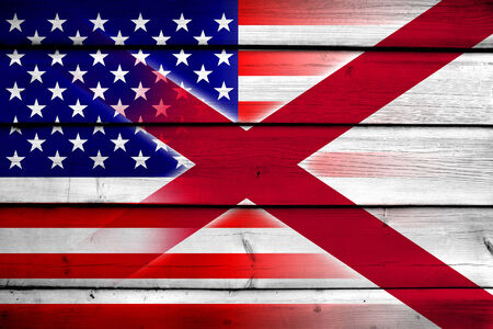 alabama state: USA and Alabama State Flag on wood background