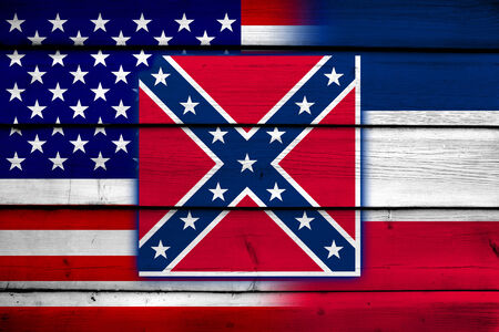coupled: USA and Mississippi State Flag on wood background