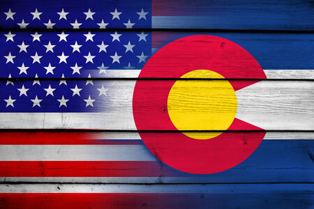 consolidated: USA and Colorado State Flag on wood background