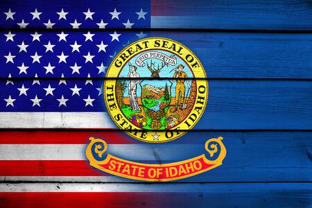idaho state: USA and Idaho State Flag on wood background