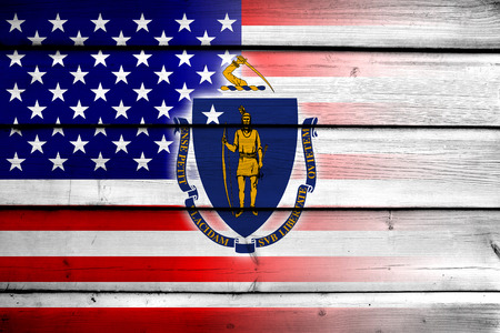 consolidated: USA and Massachusetts State Flag on wood background