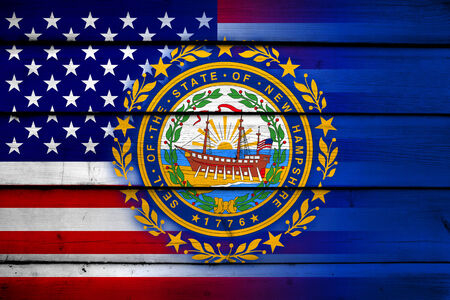 coupled: USA and New Hampshire State Flag on wood background Stock Photo