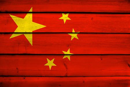 far east: China Flag on wood background