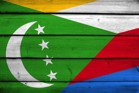 comoros: Comoros Flag on wood background