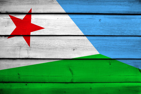 Djibouti Flag on wood background photo