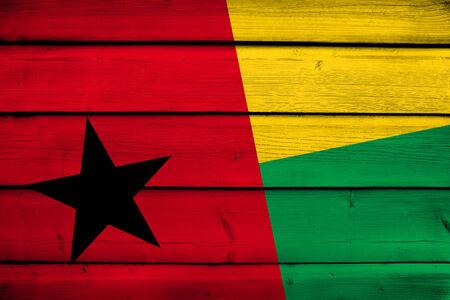 guinea bissau: Guinea Bissau Flag on wood background Stock Photo