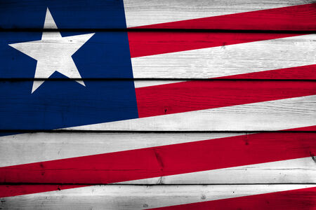 Liberia Flag on wood background photo