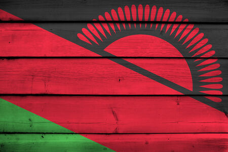 malawi flag: Malawi Flag on wood background