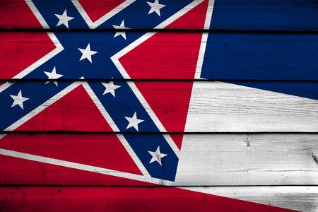 Mississippi State Flag on wood background photo