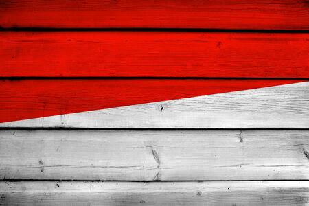 monaco: Monaco Flag on wood background