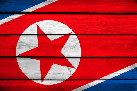 korea flag: North Korea Flag on wood background