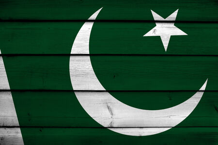 Pakistan: Pakistan Flag on wood background Stock Photo
