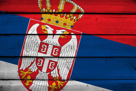 Serbia Flag on wood background Stock Photo