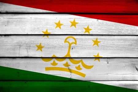 tajikistan: Tajikistan Flag on wood background Stock Photo