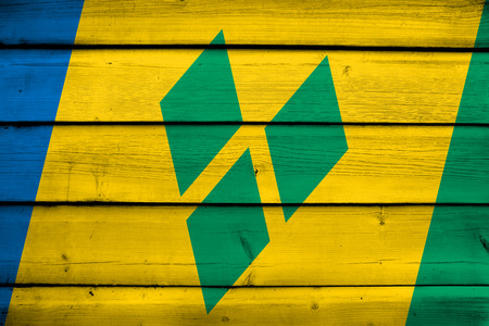 grenadines: Saint Vincent and The Grenadines Flag on wood background