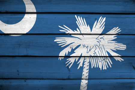 South Carolina State Flag on wood background photo