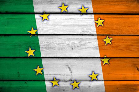 Ireland and European Union Flag on wood background