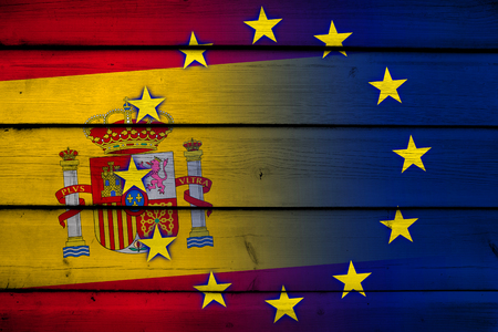 Spain and European Union Flag on wood background