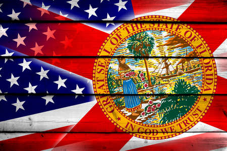 florida state: USA and Florida State Flag on wood background Stock Photo