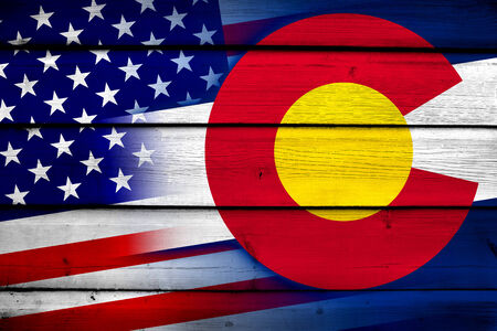 state of colorado: USA and Colorado State Flag on wood background