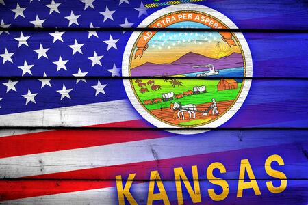 coupled: USA and Kansas State Flag on wood background Stock Photo