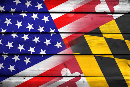 consolidated: USA and Maryland State Flag on wood background