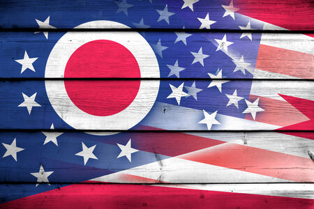 consolidated: USA and Ohio State Flag on wood background