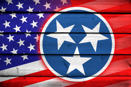 coupled: USA and Tennessee State Flag on wood background Stock Photo