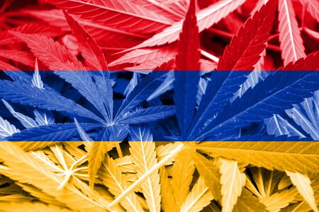 smuggling: Armenia Flag on cannabis background. Drug policy. Legalization of marijuana