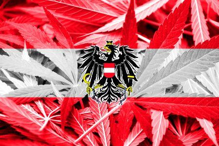thc: Austria Flag on cannabis background. Drug policy. Legalization of marijuana