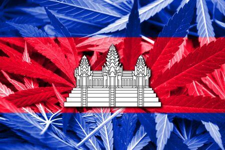 drug dealer: Cambodia Flag on cannabis background. Drug policy. Legalization of marijuana