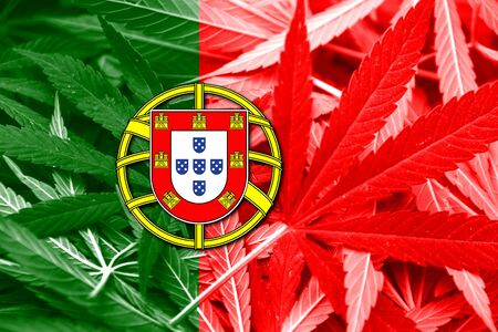 law of portugal: Portugal Flag on cannabis background. Drug policy. Legalization of marijuana Stock Photo