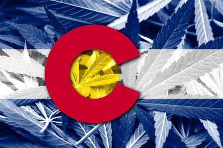 Colorado State Flag on cannabis background. Drug policy. Legalization of marijuana
