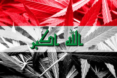 middle joint: Iraq Flag on cannabis background. Drug policy. Legalization of marijuana