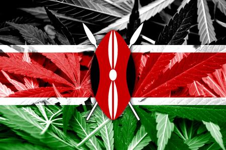 thc: Kenya Flag on cannabis background. Drug policy. Legalization of marijuana