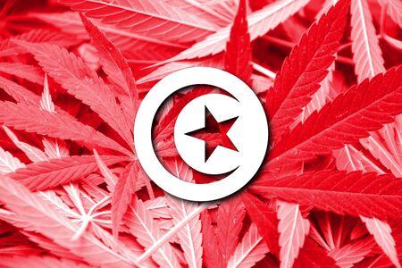 drug dealer: Tunisia Flag on cannabis background. Drug policy. Legalization of marijuana Stock Photo