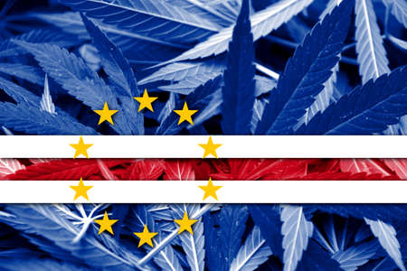 grass close up: Cape Verde Flag on cannabis background. Drug policy. Legalization of marijuana Stock Photo