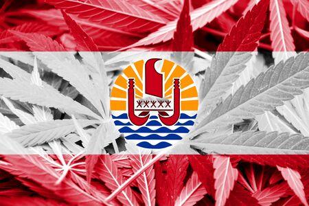 drug dealer: French Polynesia Flag on cannabis background. Drug policy. Legalization of marijuana