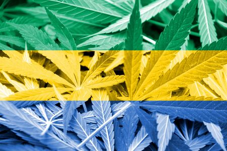 smuggling: Gabon Flag on cannabis background. Drug policy. Legalization of marijuana