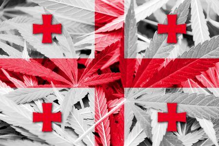 thc: Georgia Flag on cannabis background. Drug policy. Legalization of marijuana Stock Photo