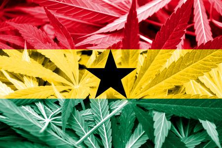 marihuana: Ghana Flag on cannabis background. Drug policy. Legalization of marijuana Stock Photo