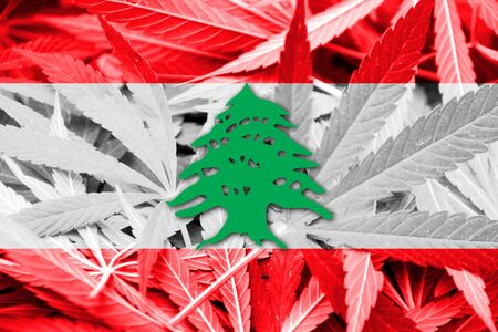 middle joint: Lebanon Flag on cannabis background. Drug policy. Legalization of marijuana