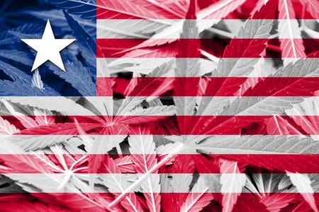 drug dealer: Liberia Flag on cannabis background. Drug policy. Legalization of marijuana Stock Photo