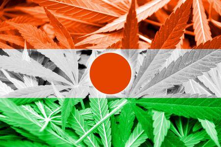 drug dealer: Niger Flag on cannabis background. Drug policy. Legalization of marijuana