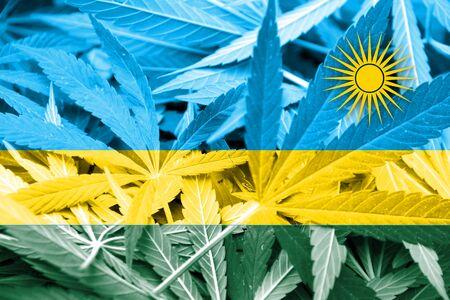 thc: Rwanda Flag on cannabis background. Drug policy. Legalization of marijuana Stock Photo
