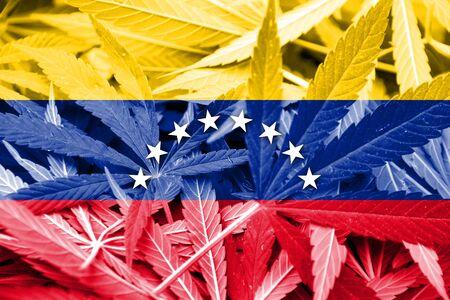 grass close up: Venezuela Flag on cannabis background. Drug policy. Legalization of marijuana